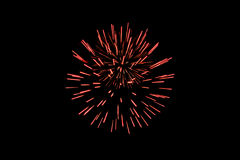 Red fireworks. Red spherical fireworks on black background stock photo