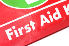 Red first aid emergency kit. Red emergency first aid kit taken against a white background Royalty Free Stock Images