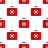 Red First Aid Kit Bag Icon Seamless Pattern. A seamless pattern with a white and red first aid kit bag flat icon, isolated on white background. Useful also as Royalty Free Stock Photo