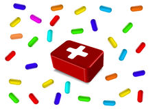The red first-aid set. And the scattered tablets Stock Photography