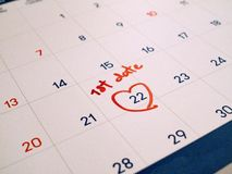 Red first Date marked on white calendar agenda target date for romance and dating.  stock images
