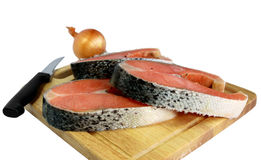 Red fish. Chunks of red fish lie on a chopping board Stock Photography