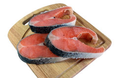 Red fish. Chunks of red fish lie on a chopping board Royalty Free Stock Photos