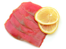 Red fish. Fillet of red fish with lemon slices on white background Royalty Free Stock Photos