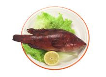 Red fish. With lettuce and lemon stock images