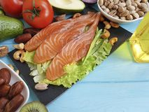 Red fish, avocado on blue wooden fillet. Red fish, avocado on blue wooden organic fillet Stock Photography