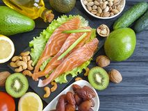 Red fish, avocado on a wooden healthy food assorted. Red fish, avocado on wooden healthy food dates assorted Stock Photos