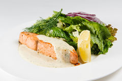 Red fish with baked vegetables Stock Photo