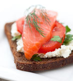 Red fish canape with cream cheese and tomato Stock Photography