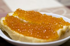 Red fish caviar on bread. enjoy your meal stock photos