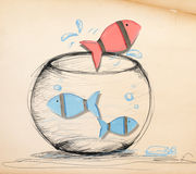 Red Fish Escaping from Fishbowl.  Royalty Free Stock Photos