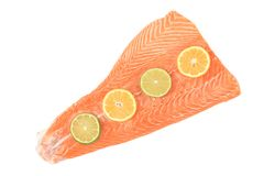 Red fish fillet with lemon slices. Stock Photo