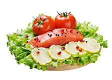 Red fish and fresh vegetables Stock Photography