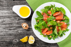 Red fish healty salad on white dish Stock Images