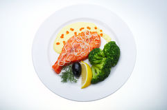 Red fish with lemon. Olive and Caviar Stock Photo