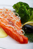 Red fish with lemon. Olive and Caviar Stock Image