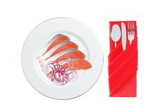 Red fish with onion on the plate isolated on white Royalty Free Stock Image