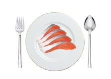 Red fish on the plate isolated on white Royalty Free Stock Image
