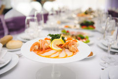 Red Fish and Prawns with Lemon Royalty Free Stock Image