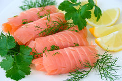 Red fish, salmon. With dill, parslay and lemon Stock Photo