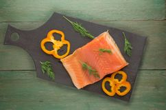 Red fish trout fillets on a plate. Stock Images