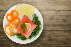 Red fish trout fillets on a plate. Stock Photography