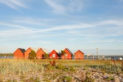 Fishing houses in Katthammarsvik Gotland. Red fisherman huts by the coast in Sweden Gotland Katthammarsvik a sunny day in the summer with blue royalty free stock photography