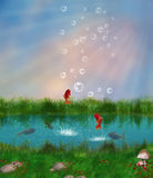 Red fishes in a pond. Little red fishing are swiming and jumping in a pond Stock Image