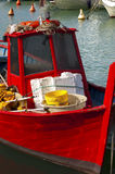 Red fishing boat. Red small fishing boat docked in port - Italy Lerici royalty free stock image