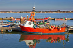 Red Fishing boat. In a pier Stock Images