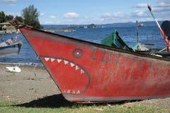Red fishing boat at Bolsena lake stock images