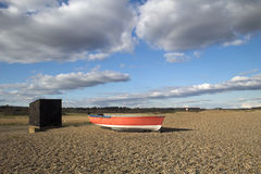 Red Fishing Boat on Dunwich Beach, Suffolk, England Stock Photography
