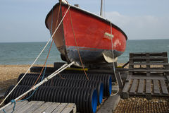 Red fishing boat out of the water Royalty Free Stock Photos