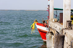 Red fishing boat stay harbor without fisherman Royalty Free Stock Images