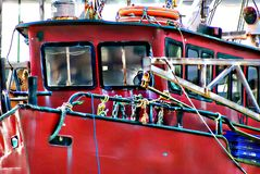 Red Fishing Boat Trawler. The red fishing boat trawler is heading out to see to catch hundreds of fish to supply to the shops and supermarkets.  Fresh fish is Royalty Free Stock Image