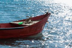 Red fishing boat in the water Royalty Free Stock Images