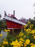 Red fishing boats in canals. Red fishing boats canals flower sky yellow royalty free stock photos