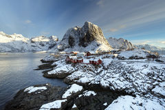 Red fishing hut (rorbu) on the Hamnoy island in winter, Reine, L Stock Images