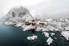 Red fishing hut (rorbu) on the Hamnoy island in winter, Reine, L Royalty Free Stock Photos