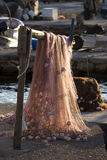 Red fishing net on beam Royalty Free Stock Image