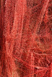 A red fishing net hanging on a wall Royalty Free Stock Photos
