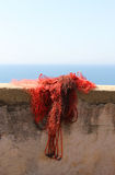red fishing net upon a wall Stock Images