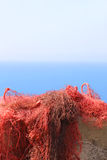 Red Fishing net upon a wall Royalty Free Stock Photo