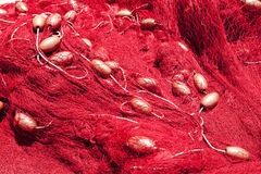 Red Fishing Nets in a Harbor Stock Photos