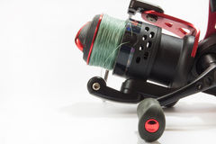 Red fishing reel in close view Stock Images