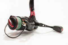 Red fishing reel in close view Stock Photos