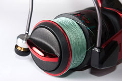 Red fishing reel in close view Royalty Free Stock Images