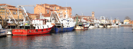 Red fishing vessel other ships moored in the port of the Mediter Royalty Free Stock Photos
