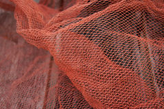Red fishnet. The tools for fishing Royalty Free Stock Photography