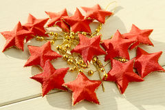 Red five-pointed stars garland. Stock Photography